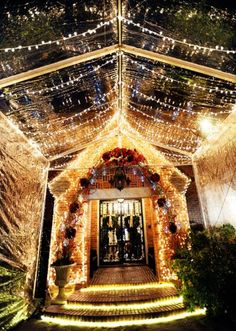 Such an enchanting and holiday inspired reception entryway! This is the perfect way to wow your guests on your special day! Photo by Andrea Polito Photography #wedding #holiday #christmas #event #lights #entryway #entry #reception