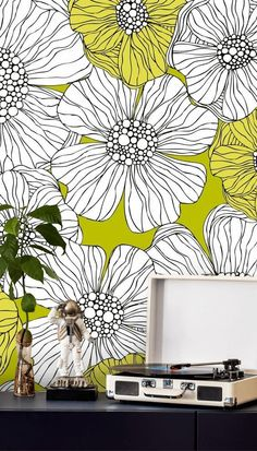 Do you love retro home interiors? Are you obsessed with the style of the '60s and '70s? Channel your inner hippy and create the ultimate flower power living room or bedroom for a proper statement! Place this bright yellow retro floral mural behind your chest of drawers or sideboard and style with a retro record player and funky décor to complete the look! Create your custom mural at Wallsauce.com!