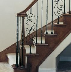"""MustKnowHow, Replacing an iron staircase baluster.  Can also be found here under """"Rod Iron Staircase Railing.""""   http://www.houses-designs.com/banister-staircase.html"""