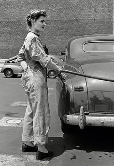 A woman pumps gas, June 1943. My maternal grandmother worked pumping gas and cleaning windshields and general auto maintenance during world war II in Hoquiam/Aberdeen Washington US