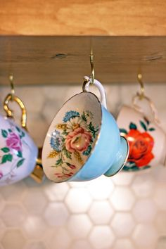 Vintage tea cups displayed in kitchen open shelving / The Sweet Escape