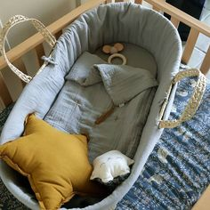 Numero74 Moses Basket in Silver Grey bedding, embellished with our Star Cushion in gold!