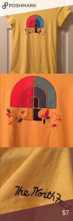 The north face yellow t shirt with flower design Excellent quality T-shirt. Add some jazz to your casual wardrobe today with this yellow the north face T-shirt with floral design on back. The North Face Tops Tees - Short Sleeve