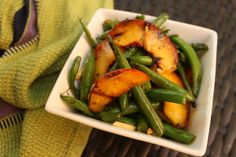 Take something unexpected (and delicious) to the next picnic. Grilled green beans & peaches with mint.