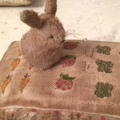 """""""Little bunny in veg garden"""".#tbt I'm working on a new one for """"In the Garden"""" pincushions. #lovemakingthese. #rabbithillprimitives"""