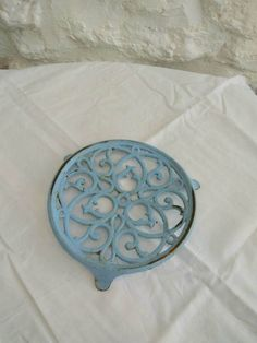 Check out this item in my Etsy shop https://www.etsy.com/uk/listing/503411278/vintage-french-trivet-or-pot-stand