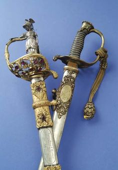 North & South. || Presentation high grade foot officer's sword to Capt. Josiah Pickett (later a General), Company F, 25th Massachusetts. ...   High grade jeweled statue gripped presentation sword to Capt. Henry Brennan, 20th Kentucky Volunteers.