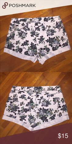 "White Floral Shorts White stretchy mid rise shorts with flowers on them from Forever 21. Worn only twice and still in great condition! 71% cotton, 21% polyester, 2% spandex and 11"" long Forever 21 Shorts"