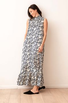 2a8a321008f6 Il  longDress Maestrale avorio è un  abito  chemisier lungo fino alla  caviglia con