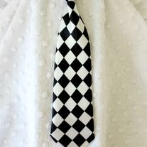 This satin tie comes with stretchy elastic for around the neck.  *28cm long & 7cm bottom widest point *Best suited for babies, toddlers and up to age 6. *Enjoy the flat rate shipping up to 5 ties.