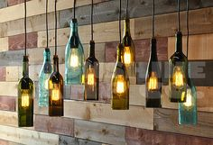 This is a 10 bottle chandelier made from any 10 bottles of your choice. It can be made with liquor bottles or wine bottles. The birchwood ply canopy is 18 x 36, but can be made in virtually any dimension. There is a metal firewall installed on the back side. The fixture floats down 1 from the ceiling on a frame of oak and the whole unit is stained dark walnut. I can do a lighter or natural stain as well. Please let me know you preference. The bottle tops can either be metal caps as featured…
