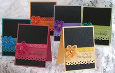 handmade notecard set ... black embossed fromt with a pop of bright color ... large sentiment on a band of color ... edge punching ... polka dot ribbon ... dimentsional flower ... like how each card is black with just one other color for all of the embellishments ...