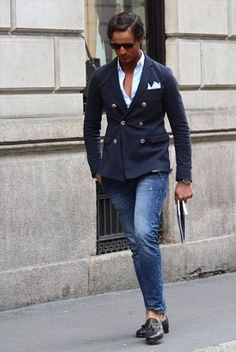 Shop this look on Lookastic:  https://lookastic.com/men/looks/double-breasted-blazer-long-sleeve-shirt-jeans-tassel-loafers-pocket-square/3847  — White Long Sleeve Shirt  — White Pocket Square  — Navy Double Breasted Blazer  — Blue Jeans  — Black Leather Tassel Loafers