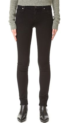 Citizens of Humanity Avedon Ultra Skinny Jeans   These black skinny jeans feature 5-pocket styling and a single-button closure. Tonal 'h' stitching at back pockets. Fabric: Super-stretch denim. 44% rayon/29% cotton/25% cupro/2% polyurethane. Wash cold. Made in the USA. Measurements    Rise: 8in / 20.25cm Inseam: 30in / 76cm Leg opening: 10in / 25.5cm