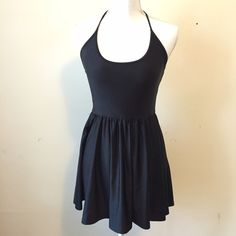 American Apparel Figure Skater Dress Short, flirty dress featuring a halter neck and breezy shirred skirt. Nylon Tricot is a stretchy, shiny fabric that's smooth and of medium thickness. 80% Nylon, 20% Elastane. Gently worn. American Apparel Dresses Mini