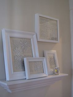 Dollar store snowflakes, white frames and vintage paper... SO pretty!