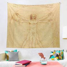 Leonardo Da Vinci - Vitruvian Man Tapestry by Emily Pigou. Get yours at my Redbubble store today. #leonardodavinci  #classicart #vitruvianman  #tapestry  #paintingtapestry #painter #vitruvianmantapestry #redbubble #giftidea #findyourthing #homedecor #homegift #wallart #painting #davinci Gaming Posters, Buy Posters, Da Vinci Vitruvian Man, Gifts For Kids, Gifts For Her, Nerd Gifts, Thing 1, Yoga Gifts, Canvas Prints