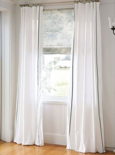 printed roman shade & solid drapes with trim detail (pottery barn)