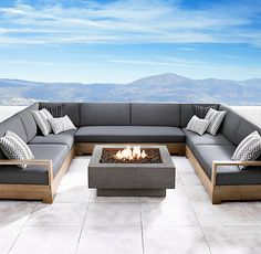 RH's Ixtapa Square Fire Table:Make an architectural statement outdoors with a clean-burning hearth. Our handcrafted fire table, artisan made from high-performance reinforced concrete, is finished with a multistep process that captures the look and luxurious feel of natural limestone. Heat resistant to the touch, it's available in a choice of either natural gas or propane to warm chilly nights.