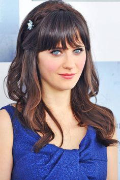 Zooey Deschanel's blunt bangs and face-framing braid are perfect for an outdoor venue #weddinghair