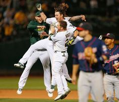 Party in Oakland -  Stephen Vogt, Brett Lawrie and Josh Reddick of the Oakland Athletics celebrate after a 3-2 walk-off win in the 10th inning against the Minnesota Twins July 18 in Oakland, Calif. - © Lachlan Cunningham/Getty Images