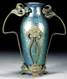 A metal mounted Loetz iridescent glass vase