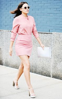Atlanta de Cadenet wears a pink top tucked into a miniskirt, and pairs the look with platform sandals and white accessories