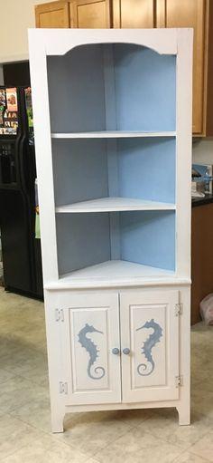 Seahorse corner cabinet