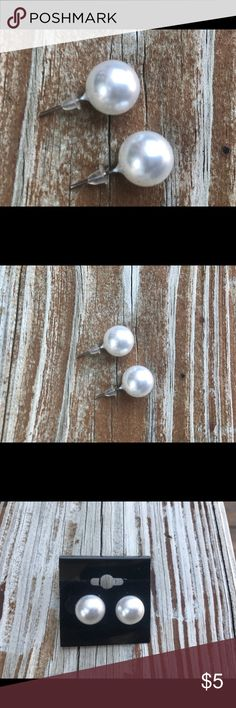 White Pearl Stud Earrings Large These are faux white pearl stud earrings are hand set with Silverplated  posts. Pearls measure approx. 10-12mm in diameter.  Great for any age!  Free surprise jewelry gift with your purchase!  Other colors available Jewelry Earrings