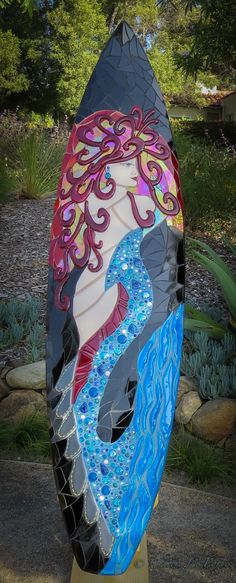 Miss Mosaic Mermaid Surfboard She is made of all glass. I handmade fused glass pieces in her tail, body and hair. Available for purchase. www.cherrielaporte.com