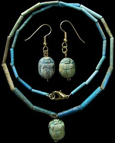 Ancient Egypt, Late Period, 664-535 BC. Beautiful necklace composed of colorful faience disk beads with a gorgeous steatite scarab pendant. Scarab from the New Kingdom (1570-1070 BC) and is highly detailed with excellent form, suspended on antique brass wire from an early 1900's collection. Re-strung on sturdy necklace wire with silver clasp. Beads are ex-Simonian family collection, Switzerland, scarab ex-British collection acquired in the 1890's-1920's.