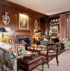 Wood paneled library fill to the brim with family treasures and...