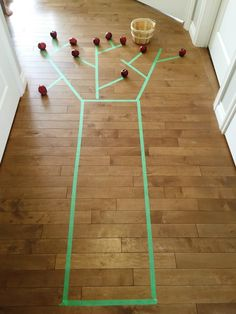 painters tape apple tree picking activity that's great for gross motor skills