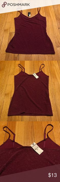 NWT Express Sparkly Red Cami New with tags Express berry red Cami tank top with beautiful metallic silver tinsel threaded through. Great for layering with a cardigan or deep cut top! Size small, originally $20 Express Tops Camisoles