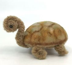 Darling tiny mohair plush and wool chenille stem Schuco Germany Noah's Ark Turtle. Beige wool chenille stem head/neck and feet. Multi colour mohair plush over carded body. No mohair thinning. Dollhouse Dolls, Dollhouse Miniatures, Chenille, Plush Animals, Terrier Dogs, Vintage Toys, Poodle, Dinosaur Stuffed Animal