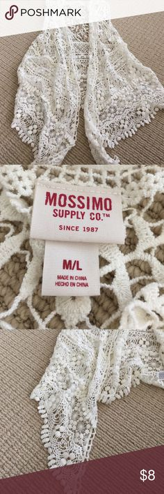 Cute sleeveless girls crochet lace vest ML Cute Target brand ivory sleeveless vest crochet lace with uneven front. Size medium large. Great condition hardly worn! Mossimo Supply Co Shirts & Tops