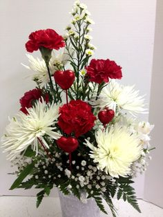 We love to add red hearts to your Valentine's Day floral arrangements!