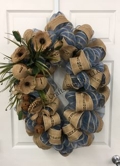 Blue with burlap strip deco mesh with burlap ribbon and burlap flowers on oval base. With rusty bells. Everyday 2017