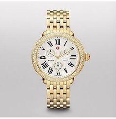 Serein Diamond Gold One hundred glittering diamonds encircle this elegant gold timepiece. Roman numerals and the signature MICHELE logo grace the silver tone chronograph dial. The gold plated stainless steel bracelet is interchangeable with any 18mm MICHELE strap.