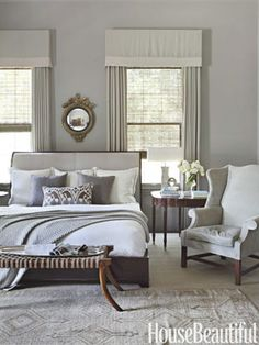 "To make the master bedroom of this Alabama home more dynamic, designer Betsy Brown choose bright white bedding and a white lampshade. ""A room of creams and beiges needs something stark and shiny white. You have to interject elements that add intense personality,"" says Brown."