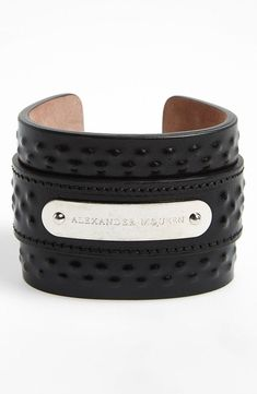A nice addition to any outfit | Alexander McQueen covered stud leather cuff bracelet #alexandermcqueenskull
