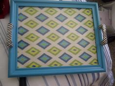 Turn a 2 dollar thrift store frame into a tray.   1. Take apart, clean and decide if glass is salvageable or not.  2. Sand and paint frame.  3. I had to get replacement glass from Hobby Lobby (50% off).  4. Mod Podge fabric to backing.  5. Attach handles (another Hobby Lobby 50% off purchase).  6. Reassemble and Wa-La! A tray!