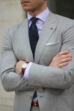 for a classic summer look - try a light grey suit, lavender shirt, navy tie with white pindots, and a red lapel pin to finish. #menstyle #fashion