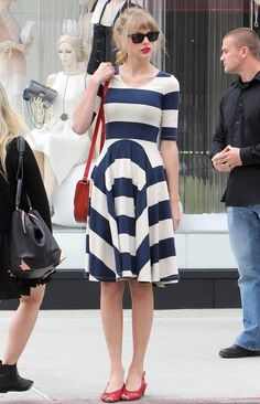 Taylor Swift in nautical blue and white stripes and red accessories