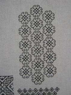 """This pattern is number 20 from Rosemary Drysdale's The Art of Blackwork Embroidery, adapted a little in that I shifted each line of medallions so that they nested together a little and left less white space."""