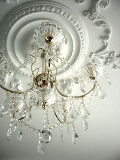 white with decadent chandelier