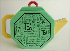 Octagonal Teapot ... flat sided octagon shape with puns on word tea written on the sides, bright primary colours, ceramic