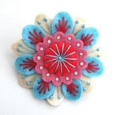felt flower by clausatie.  Cute brooch or hairpiece...