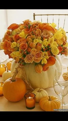 Pumpkin vase fall centerpiece - could plant out with something and then just plant whole thing in garden after? Would be eating pumpkin pie for a long time though! Could etch table number into pumpkin? Pumpkin Centerpieces, Wedding Centerpieces, Wedding Decorations, Table Decorations, Pumpkin Vase, Centerpiece Ideas, Pumpkin Flower, Wedding Ideas, Pumpkin Bouquet