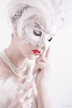 White lace, feather and crystal mask. #masks #venetianmsks #masquerade http://www.pinterest.com/TheHitman14/artwork-venetian-masks-%2B/